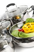 pic of dutch oven  - Stainless steel pots and pans isolated on white background with vegetables - JPG