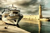 lighthouse and boat in old port of Rethimno- artistic toned picture