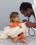 image of health-care  - Caring Doctor with a child in a hospital - JPG