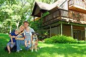 stock photo of chalet  - a young attractive happy family of four - JPG