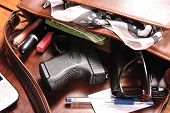 foto of handgun  - Handgun and accessories falling from a woman - JPG