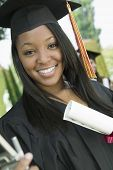 stock photo of convocation  - Closeup portrait of happy female student with certificate in college campus - JPG
