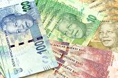 stock photo of nelson mandela  - South African new bank notes in piles, finances ** Note: Shallow depth of field - JPG