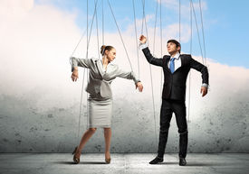 pic of male-domination  - Image of businesspeople hanging on strings like marionettes - JPG