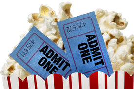 pic of matinee  - Close up shot of two movie tickets sticking up out of a tub of popcorn and shot on a white background - JPG