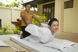 foto of thai massage  - Woman getting Thai massage from professional masseuse - JPG