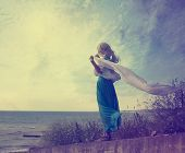 stock photo of lonely woman  - Vintage Photo of Lonely Woman with Waving Scarf at the Sea - JPG