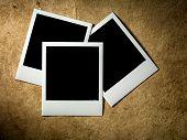 stock photo of polaroid  - Polaroid Film Vintage empty photo cards on paper background - JPG