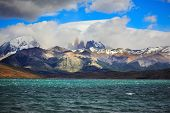 Fantastic beauty of the national park Torres del Paine in Chilean Patagonia. Strong wind drives wave
