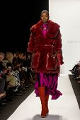 NEW YORK-FEB 10: A model walks the runway at the Dennis Basso fashion show during the 2014 Mercedes-
