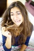 stock photo of split ends  - Woman holding destroyed hair with split ends - JPG