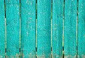 stock photo of slit  - Shabby blue wooden fence with wide slits  - JPG