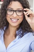Smiling happy beautiful young woman or girl wearing geek glasses