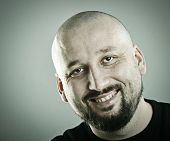 stock photo of half-shaved hairstyle  - Portrait of a half bald man - JPG
