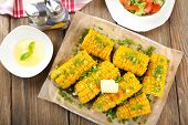 foto of corn cob close-up  - Grilled corn cobs on table - JPG