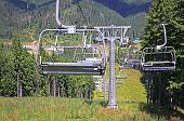 stock photo of ropeway  - Ropeway on a top of one of the mountains of Bukovel ski resort Carpathians - JPG