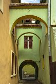 pic of arcade  - Colorful medieval architecture house with arcades and passage in the fortified citadel of Sighisoara Romania a UNESCO World Heritage Site - JPG