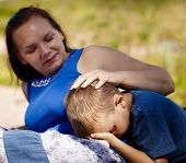 foto of love hurts  - A mother comforts her son which is little hurt - JPG