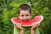 foto of watermelon  - Kid eating red ripe watermelon - JPG