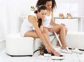 stock photo of covenant  - Women buy shoes at a shoe store - JPG
