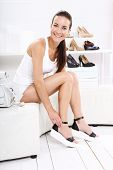 image of covenant  - Women buy shoes at a shoe store - JPG
