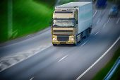picture of moving van  - large van with load moves along road - JPG