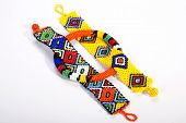 stock photo of curio  - three pieces of brightly colored beaded zulu jewelry - JPG