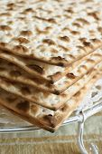 stock photo of matzah  - Matzah crackers traditionally eaten during the Passover holiday - JPG