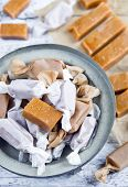 picture of toffee  - Sweet caramel toffee caramels on wooden table - JPG