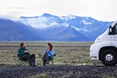 stock photo of campervan  - Travel couple by mobile motor home RV campervan - JPG
