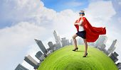 picture of hero  - Young confident woman in super hero costume - JPG