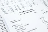 stock photo of accounting  - Income statement with detail list of revenues and expenses accounting concept for small business black and white tone image - JPG