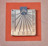 picture of sundial  - Sundial on facade of house in sunny day - JPG