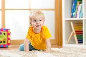 picture of crawling  - crawling funny baby boy indoors at home - JPG