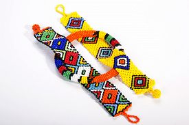 pic of zulu  - three pieces of brightly colored beaded zulu jewelry - JPG