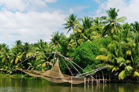 picture of alleppey  - Coco trees reflection and chinese fishing nets at back waters of Kerala India - JPG
