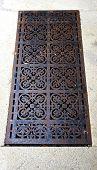 stock photo of manhole  - manhole cover pattern in europe iron ornament - JPG