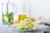 picture of pesto sauce  - Macaroni with pesto pesto with olive oil herbs nuts and Parmesan sprinkled with fresh basil and parmesan - JPG