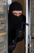 foto of raider  - Thief entering a private home to steal - JPG