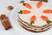 stock photo of sponge-cake  - Easter sponge cake with carrots and icing on white background - JPG