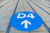 image of orientation  - blue arrow on pavement slabs - JPG