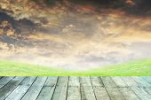 stock photo of paving  - green grass and orange sky with wooden paving - JPG
