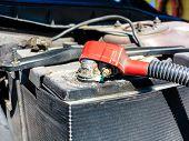 foto of terminator  - closeup old battery car terminal in engine room - JPG