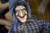 pic of flea  - Close up of a witch doll in a flea market - JPG