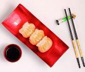 pic of siomai  - Vietnam style steamed shrimp dumplings served on a white background - JPG