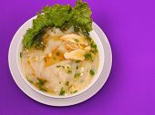 stock photo of glass noodles  - Glass noodle soup with chicken and beansprouts on a purple background - JPG