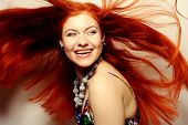 picture of flowing hair  - Beautiful young happy woman with long flowing red hair - JPG
