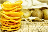 stock photo of potato chips  - Natural potato chips in a package and potatoes in the bag - JPG