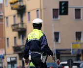 foto of policeman  - Italian policeman in uniform while blocking traffic with the Red paddle to block cars - JPG