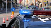 stock photo of police  - Blue flashing sirens of police car during the roadblock in the city - JPG